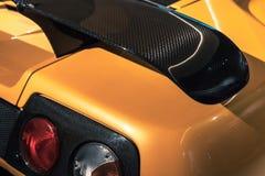 Spoiler de carbone d'aérodynamique de voiture et lumières arrière Photo libre de droits