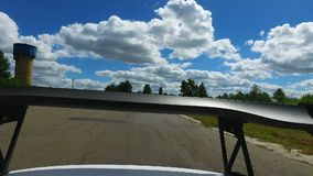 Spoiler on moving race car, automotive aerodynamic device, modified design. Stock footage stock footage