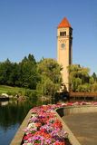 Spokane Clock Tower. Spokane, WA Clock Tower and petunias as seen from Riverfront Park royalty free stock photos