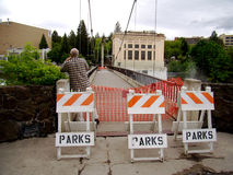 Spokane Suspension Bridge Closed. Spokane River rises above flood stage and the parks department closes one of the two Canada Island suspension bridges. Here the stock photos