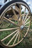 Spoked wagon wheel. Wide angle view of a wooden spoked wagon wheel Stock Photos