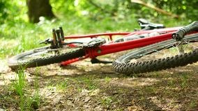 Spoked wheel of an overturned mountain bike. Spoked wheel of an overturned mountain bike stock footage