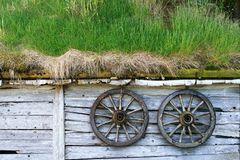 Spoked wheels at a wooden hut Stock Images