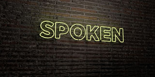 SPOKEN -Realistic Neon Sign on Brick Wall background - 3D rendered royalty free stock image Royalty Free Stock Photo