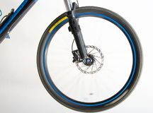 Spokes invisible. Wheel of a bicycle turning making the spokes invisible royalty free stock photo
