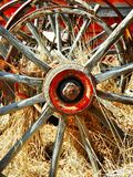 Through The Spokes. Wagon wheel old and worn Stock Images