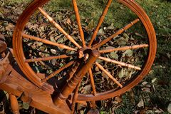 Spokes and wheel of a spinning wheel. A closeup of a very old wheel and spokes of a hand crafted spinning wheel royalty free stock image