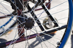 Spokes on the wheel of a wheelchair Royalty Free Stock Images