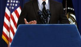 Spokesperson giving a speech announcement at press conference. Spokesperson giving a speech announcement during press conference stock images
