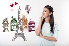 Spokojny nauczyciel ono uśmiecha się podczas gdy marzący o Paryż obrazy stock
