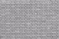 Spokojnych szarość ściana z cegieł barwiony tło Obrazy Royalty Free