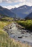 Spol river with church of Santa Maria in Livigno Italy Stock Photo