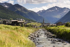 Spol river with church of Santa Maria in Livigno Italy Stock Images