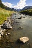 Spol river with church of Santa Maria in Livigno Italy Royalty Free Stock Photo