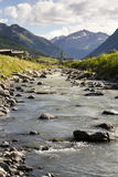 Spol river with church of Santa Maria in Livigno Italy Royalty Free Stock Image