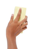 Sponge. Hand holding a sponge and cleaning something Royalty Free Stock Photos