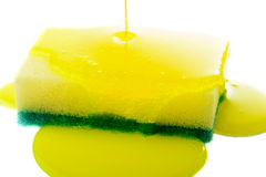 Sponge. Closeup view of liquid soap being poured on a dish sponge Stock Photography