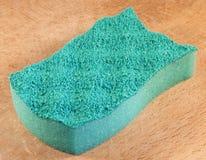 Sponge. Image of dish washing sponge on wooden background Royalty Free Stock Photos