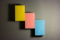 Sponge army. Stack of colorful sponges in a row Royalty Free Stock Photography