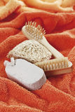 Sponge, brushes and pumice on towel stock image