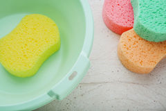 Sponge and bucket to wash Stock Photos