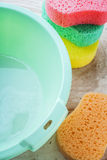 Sponge and bucket to wash Royalty Free Stock Photography