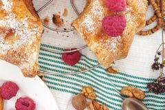 Sponge cake with apple, raspberry and cinnamon. Top view. Stock Image