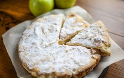 Sponge cake with apples,Apple pie,fruit biscuit with powder royalty free stock image
