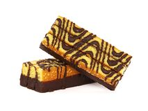 Sponge cake bar with chocolate glaze. Sponge Cake with chocolate glaze isolated on white background stock photography