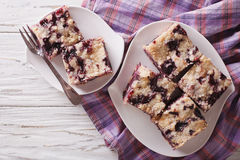 Sponge cake with blueberries close-up on a plate. horizontal top Royalty Free Stock Photos
