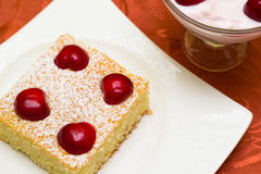 Sponge cake with cherries Stock Photos