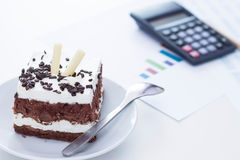 Sponge cake with chocolate on the desk. Stock Images