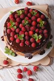 Sponge cake with chocolate and fresh raspberries vertical top vi Royalty Free Stock Photography