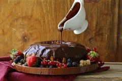 Sponge cake with chocolate ganache Stock Photography