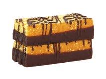 Sponge cake bar with chocolate glaze. Sponge Cake with chocolate glaze isolated on white background stock images