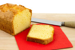 Sponge cake on chopping board Stock Photos
