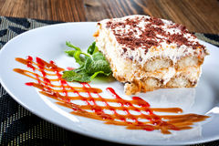 Sponge cake with cream and raspberry sauce, delicious sweet dess Royalty Free Stock Photography
