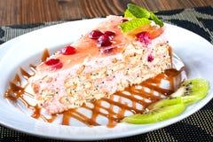 Sponge cake with cream and raspberry sauce, delicious sweet dess Stock Photos