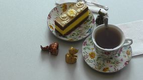 Sponge cake and a cup of tea. Sponge cake for dessert and a cup of tea stock footage