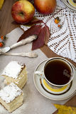 Sponge cake with a cup of tea. Still Life with slices of sponge cake sprinkled with powdered sugar and a cup of tea Royalty Free Stock Photo