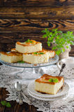 Sponge cake. Cut the slices of sponge cake with pineapple rings on a wooden table. Copy space royalty free stock photography