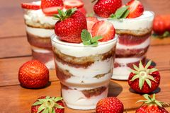Sponge cake decorated strawberries and mint. Sponge cake decorated strawberries and mint Royalty Free Stock Photography