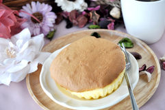 Sponge Cake Dish with Floral Background Stock Photography