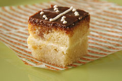 Sponge cake domino glaze Royalty Free Stock Images