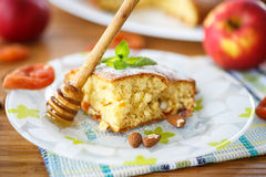 Sponge cake with dried apricots and almonds Stock Photo