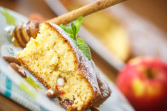 Sponge cake with dried apricots and almonds Royalty Free Stock Images