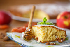 Sponge cake with dried apricots and almonds Stock Photos