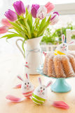 Sponge cake and easter eggs Stock Photos