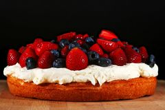 Sponge cake with fresh fruits Stock Images