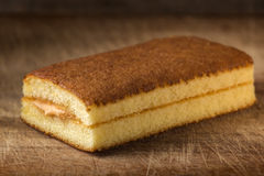 Sponge cake with fruit cream. Over wooden background Stock Photos